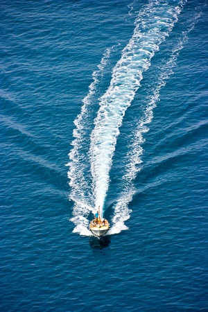 motorboats: People on the boat racing on the water Stock Photo