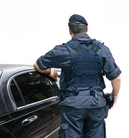garde corps: Agent de s�curit� arr�te la voiture dans la rue