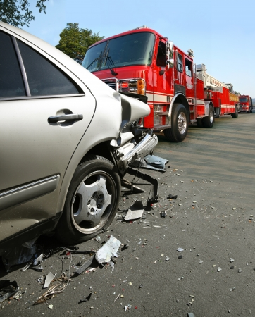 crash car: Fire truck arrives at the car accident location Editorial