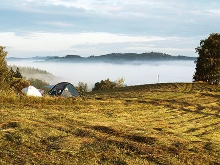 tents standing in a landscape covered in fog Stock Photo - 10413944