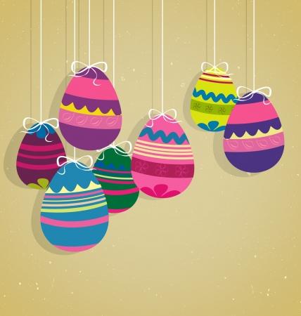 red and yellow card: Huevos de Pascua en fondo marr�n claro