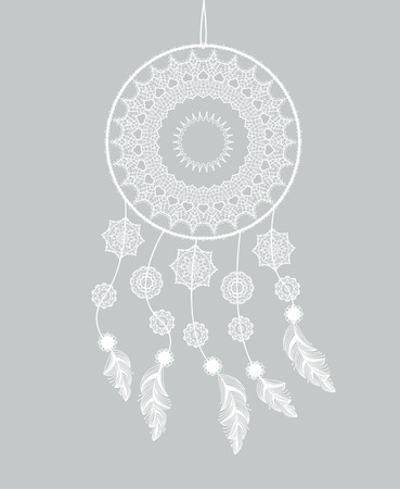 dreamcatcher: Dreamcatcher with feathers on a gray background