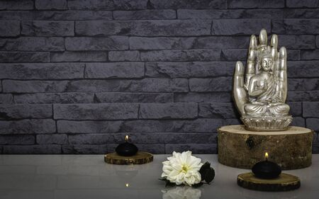 Buddha statue on a background of stones.