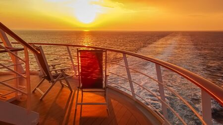 Sunset in the wake of a cruise ship.