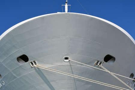 Bow of cruise ship docked.