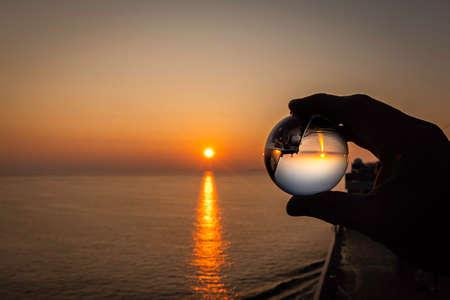Crystal ball, sunset in cruise ship. Reklamní fotografie