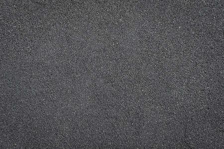 Background grains of black sea sand, fine beach sand. Reklamní fotografie