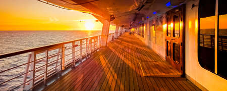 Promenade deck of a cruise ship navigating in the middle of the sea.