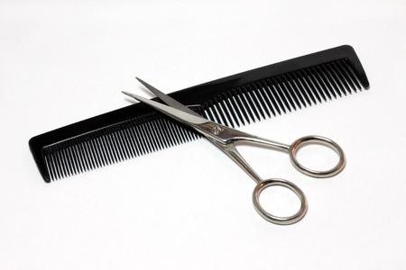 tweak: Scissors and Comb on white background