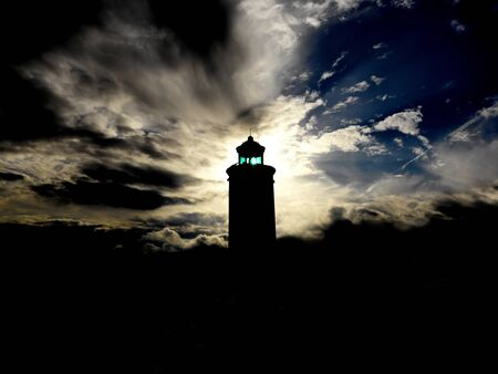 lighthouse in backlight photo