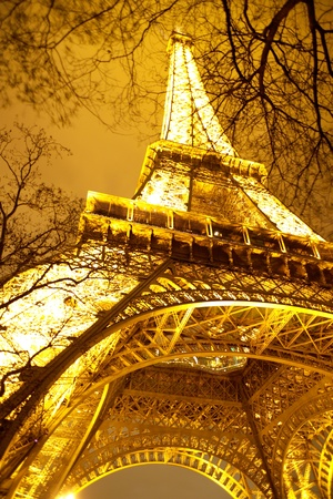 Paris, France - December 31, 2006  Eifel Tower illuminated at night in frog perspective  Editorial only  photo