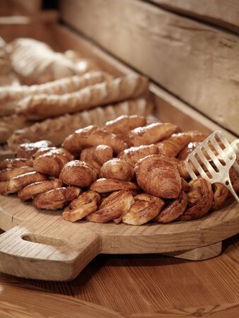french pastry: French Pastry on chopping board with bread as background Stock Photo