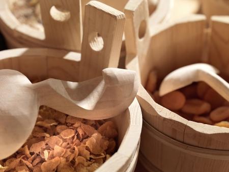 vats: rural cereal Breakfast in wooden vats and wooden spoons, Stock Photo
