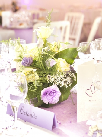 wedding food: Wedding decoration with flowers and place card in yellow and violet Stock Photo