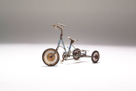 three wheeler: Studio picture of an old children tricycle Stock Photo