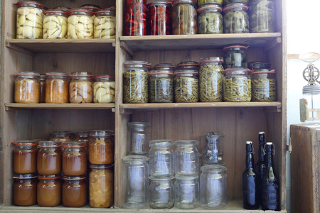 preserving jars in an old shelf