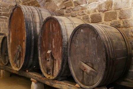 wine cellar: Four cider or wine Barells in a Basement Stock Photo