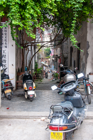 BEIHAI, CHINA - JUN, 2013: Old town street in Beihai, China, with dilapidated houses in the style of colonial architecture. Éditoriale