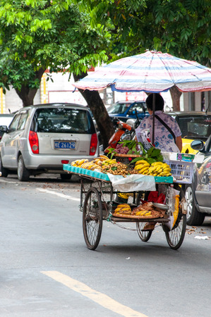BEIHAI, CHINA - JUN, 2013: Local fruit trade on the old town street in Beihai, China.