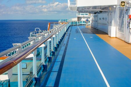 Blue treadmill along the deck of a cruise ship for Jogging while sailing.