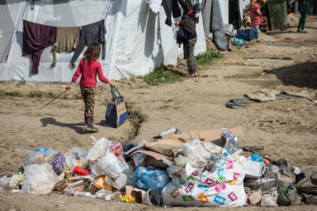 Idomeni, Paeonia, Kilkis regional unit of Central Macedonia  Greece - March 22 2016: an unaccompained minor in the refugee camp, close to a pile of garbage. 에디토리얼