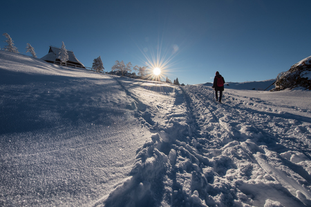 The silhouette of a winter hiker in Velika Planina, Slovenia.