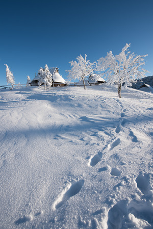 A snow covered house in Velika Planina, Slovenia.