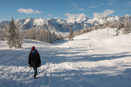 A hiker on the snow trail of Velika Planina, Slovenia. Stockfoto