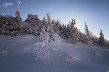The snow-covered typical herdmens houses of Velika Planina alpine plateau in Slovenia.
