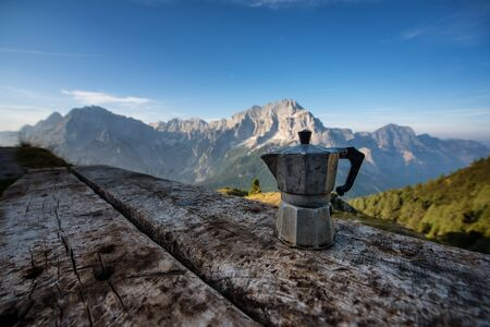 A coffe machine on a bivouac bench in the Alps