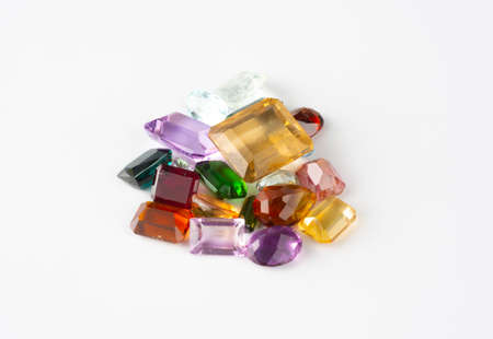 Group of precious stones and gems over white background