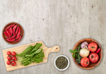 Salad ingredients over wooden table with copy space.