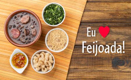 "Traditional brazilian feijoada with manioc flour, cracklings and kale. Written ""I love Feijoada"" in Portuguese."
