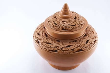 Ancient of Thai pottery with the lid photo