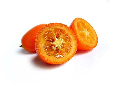 Close-up of kumquat isolated in white