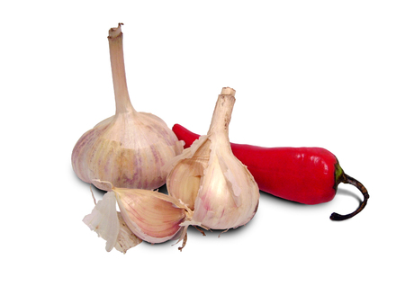 Garlic and red paprika isolated on white