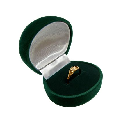 Green ring-box with gold ring isolated in white photo