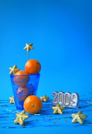 Christmas still life with tangerines and 2009 candle Stock Photo