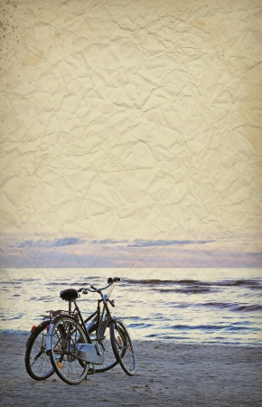 Two bycicles on old grunge paper background photo