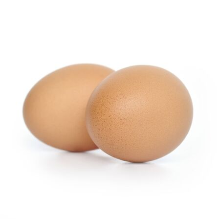 Two brown hens eggs on white background photo