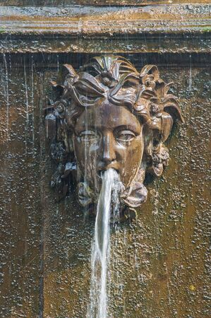 masque: Peterhof Palace St Petersburg, Russia. Masque - detail of a fountain in Upper Garden. The Peterhof Palace included in the UnescoS World Heritage list.