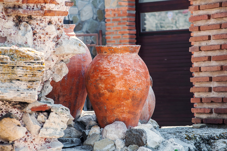 Ancient amphoras near Ruined Church of Christ Pantocrator in Nesebar. Bulgaria Stock Photo