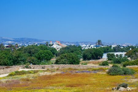 View of the town of Paphos and Agioi Anargyroi Orthodox Cathedral from the Cyprus Archaeological park at Kato , Cyprus