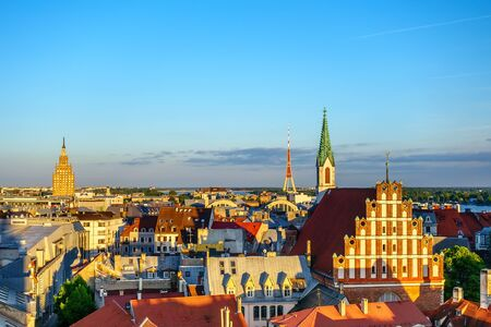 Panorama of Old Riga on sunset with St. Peters Church tower Stock Photo