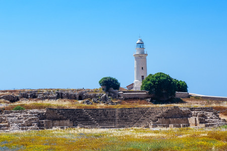 Antient greek amphitheater and lighthouse in Archaeological park at Kato Paphos, Cyprus Stock Photo