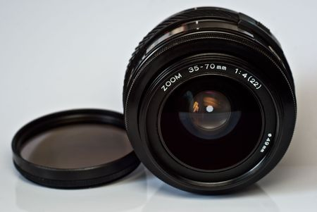 metall and glass: Black zoom lens with filter  lies on a white surface Stock Photo