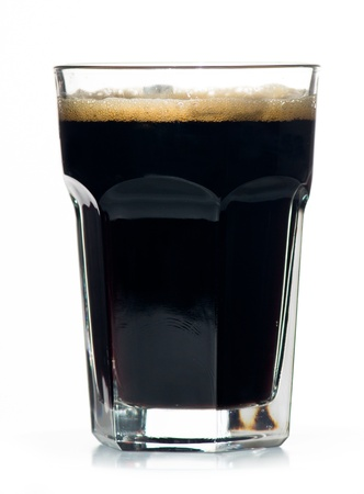 Beer glass full of cold black irish stout  Isolated  photo