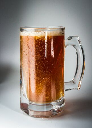 Beer glass full of cold dark beer. Isolated photo