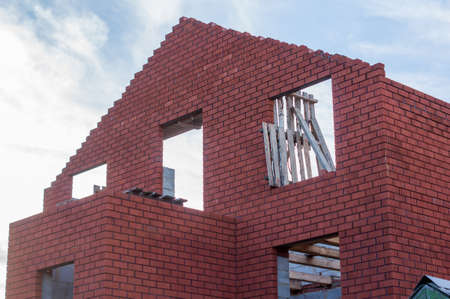 built: being built red brick house Stock Photo