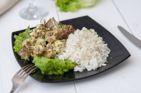 meat and alternatives: chicken liver with rice garnish and herbs